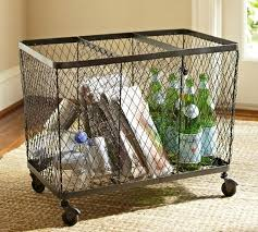 This trendy 3 sort bin station by Pottery Barn can be rolled away when needed